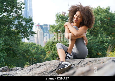 Beautiful woman doing relaxation exercises at Central Park - Stock Photo