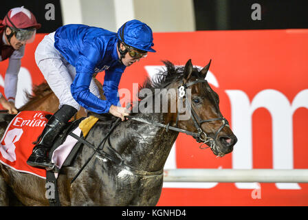 Dubai, UAE. 9th Nov, 2017. NAAEEBB, ridden by jockey Pat Cosgrave and trained by Saeed bin Suroor of Godolphin wins the Emirates A380 race at Meydan. This was Godolphin's second runner of the night in the First Race Meeting of the Dubai Race season for 2017-2018 Credit: Feroz Khan/Alamy Live News Stock Photo