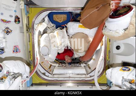 International Space Station, Earth Orbit. 09th Nov, 2017. Expedition 53 American astronaut Randy Bresnik maneuvers - Stock Photo