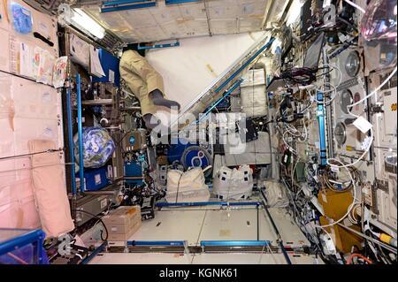 International Space Station, Earth Orbit. 09th Nov, 2017. The legs of Expedition 53 American astronaut Randy Bresnik - Stock Photo