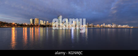 The city reflected in the Swan River at dusk. - Stock Photo