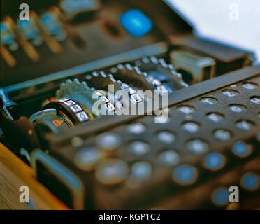Rotors and keyboard of the German World War 2 Enigma encryption/decryption device. - Stock Photo
