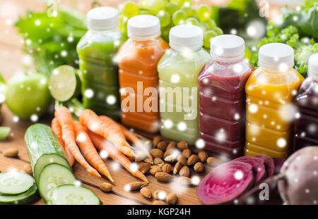 bottles with different fruit or vegetable juices - Stock Photo