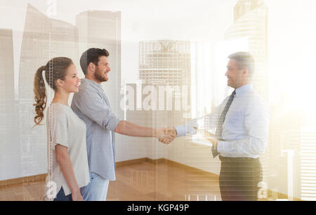 man and realtor shaking hands at new home - Stock Photo