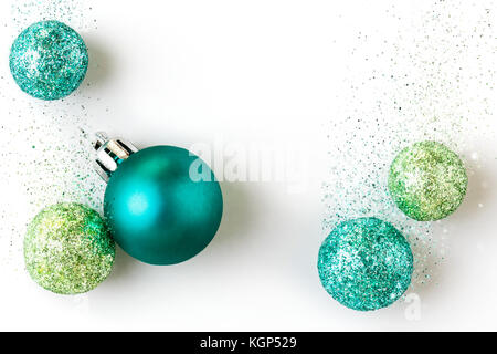 Beautiful, bright, modern, contemporary blue and green Christmas holiday ornaments decorations with sparkling glitter - Stock Photo