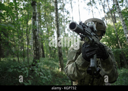 Picture of soldier in helmet with submachine gun - Stock Photo