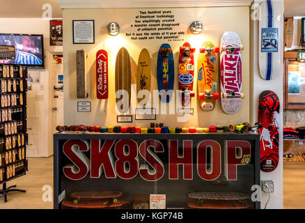 Interior of Morro Bay Skateboard Museum with display of assorted vintage skateboards and wheels, California, USA. - Stock Photo