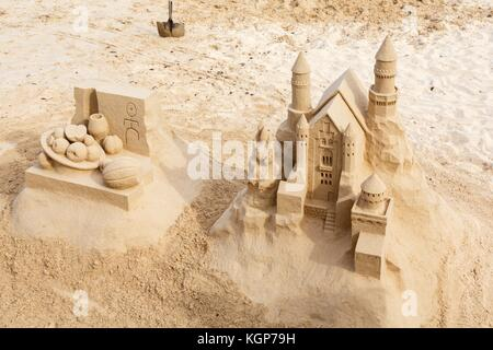 Sand art sandcastle sculptures on a beach in Fuerteventura, Canary Islands - Stock Photo