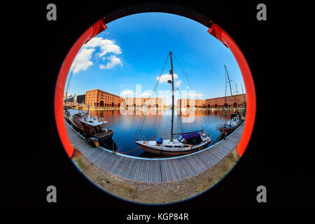 Waterfront cityscape at the Albert Dock with famous Liverpool buildings.  Fish eye perspective. - Stock Photo