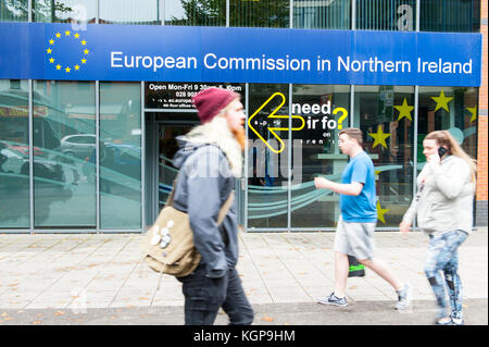 The European Commission office in Belfast, UK with people walking in fornt of it.  The Office of the European Commission - Stock Photo