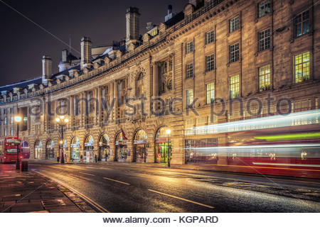 Regent Street in London is ever busy. Even early in the morning, before the Underground has opened, the double decker - Stock Photo