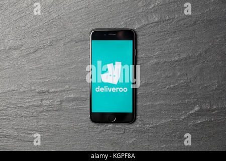 LONDON, UK - NOVEMBER 9th 2017: An apple iPhone showing the Deliveroo application logo. Deliveroo is an online takeaway - Stock Photo