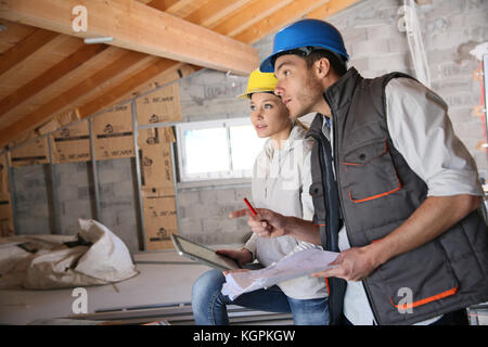 Young woman in professional training on building site - Stock Photo