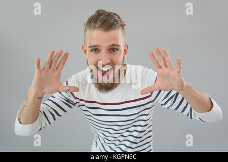 CHeerful trendy guy shouting out loud - Stock Photo
