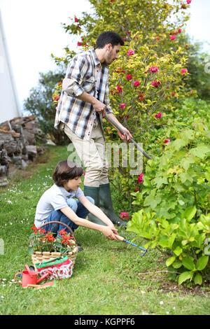 Daddy teaching little boy to do gardening - Stock Photo