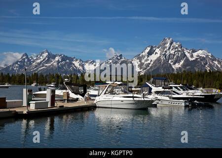 WY02556-00...WYOMING - The Teton Range is a scenic backdrop to the Colter Bay Marina on Jackson Lake in Grand Teton - Stock Photo