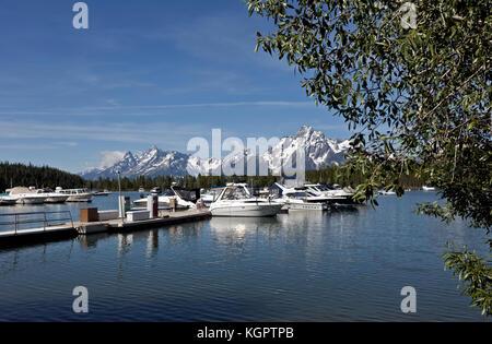 WY02557-00...WYOMING - The Teton Range is a scenic backdrop to the Colter Bay Marina on Jackson Lake in Grand Teton - Stock Photo