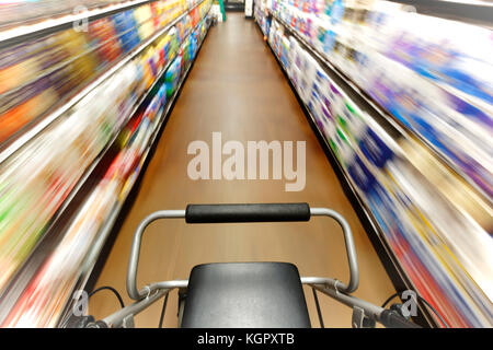 First person view of person with disability who is disoriented walking down a shopping aisle - Stock Photo