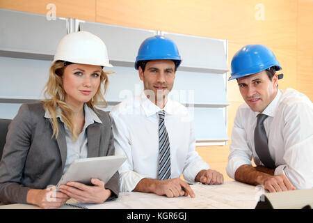 Architects and businesswomen working on construction project - Stock Photo