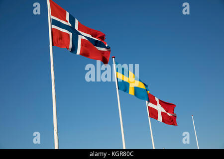 Scandinavian country flags against blue sky - Stock Photo