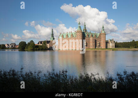 Frederiksborg Slot Castle built in the early 17th century for King Christian 4th on Castle Lake, Hillerod, Zealand, - Stock Photo