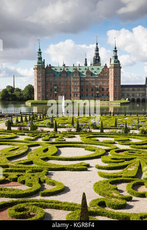 Baroque Garden of Frederiksborg Slot Castle built in the early 17th century for King Christian 4th on Castle Lake, - Stock Photo