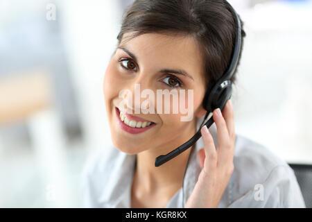 Portrait of beautiful customer service representative - Stock Photo