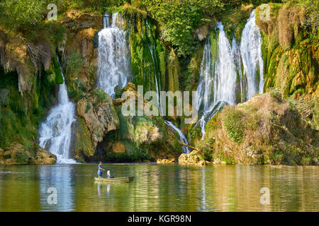 Tourists on the boat, Kravica waterfalls, Bosnia and Hercegovina - Stock Photo