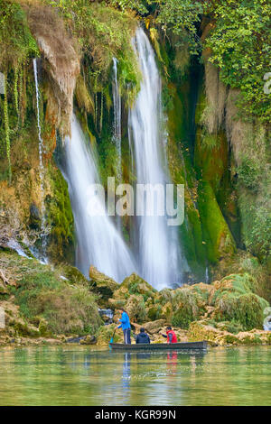 Tourists on the boat, Kravice waterfalls, Bosnia and Hercegovina - Stock Photo