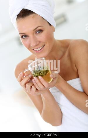 Portrait of beautiful woman drinking herbal tea - Stock Photo