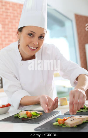 Young chef preparing plate of foie gras - Stock Photo