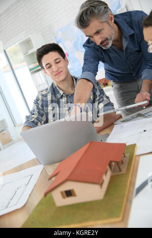 Teacher with students in architecture school - Stock Photo