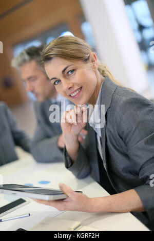 Portrait of executive woman in business meeting - Stock Photo