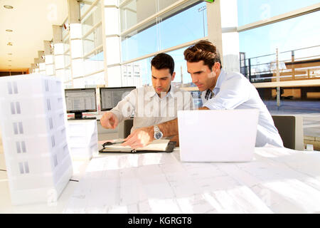 Young architects working on project - Stock Photo