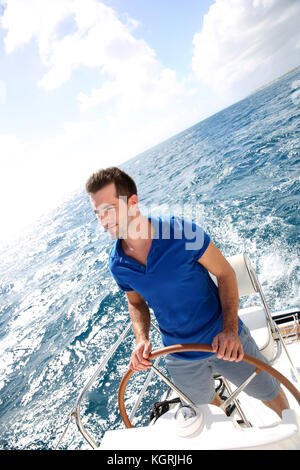 Young man sailing in caribbean sea - Stock Photo