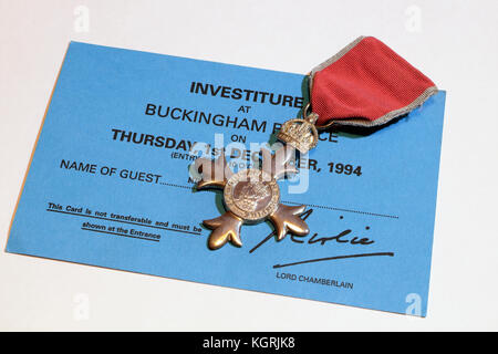 Investiture at Buckingham Palace invitation, and MBE medal - Stock Photo
