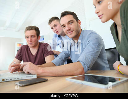 Group of young people in business training - Stock Photo