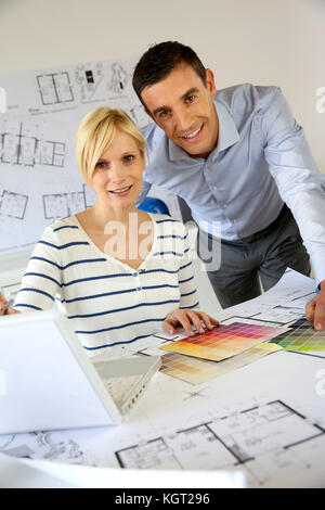 Portrait of smiling successful architects - Stock Photo
