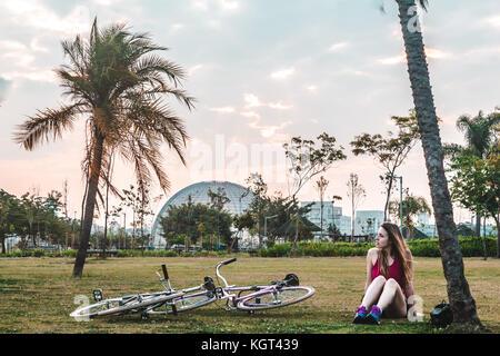 Photo of Girl with her Bike at Villa-Lobos Park in San Paulo (Sao Paulo), Brazil (Brasil) - Stock Photo