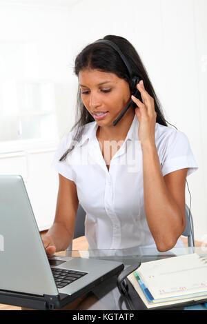 Portrait of smiling customer service operator - Stock Photo