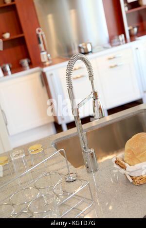 Closeup on kitchen faucet - Stock Photo