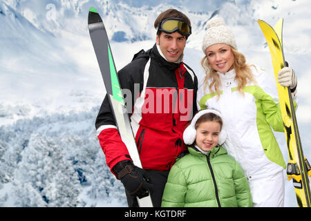 Portrait of woman at the mountain in ski outfit - Stock Photo