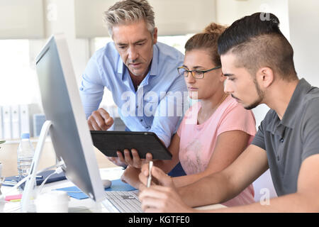 Students in design training course using tablet - Stock Photo