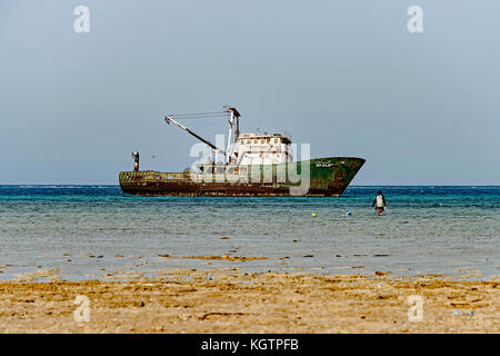 A Red Sea shipwrecked trawler abandoned in shallow water after hitting shoals. Photo taken in 2017 near Al Qattan, - Stock Photo