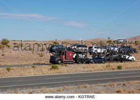 Semi-truck car hauler loaded in southeastern Arizona, USA, driver visible - Stock Photo