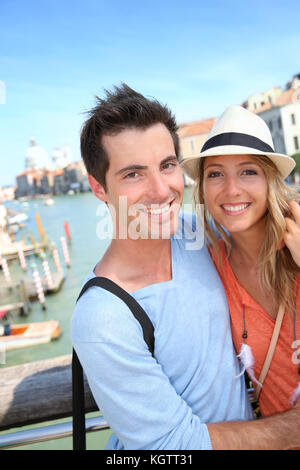Couple standing on the Academia Bridge in Venice, Italy - Stock Photo