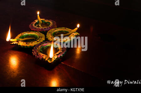 Diwali decorations with traditional Indian oil lamps with selective focus on a wooden table. Both foreground and - Stock Photo
