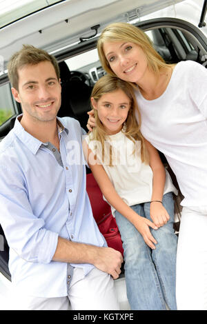 Family ready to leave for vacation with car