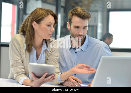 Business people working together in office - Stock Photo