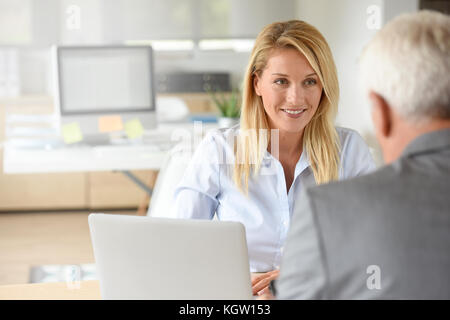 Human resources manager receiving candidate for job - Stock Photo